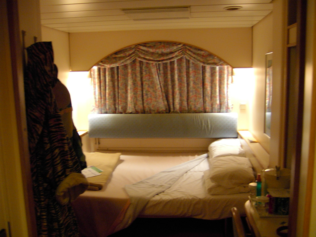 Our stateroom. There's a little round porthole behind the curtains.
